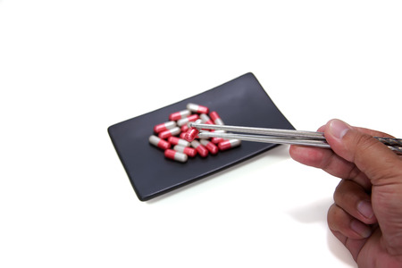 drug use: Drug use than is necessary, Drug overdose, On black square ceramic plate, Eating with chopsticks
