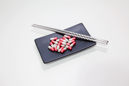 drug use: Drug use than is necessary, Drug overdose, On black square ceramic plate with chopsticks