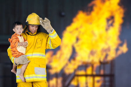 firefighter, fireman rescued the child from the fire