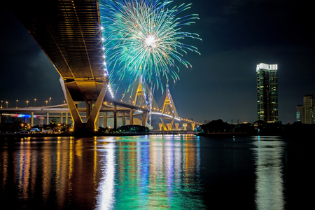thailand art: Under view of Bhumibol Bridge with fireworks,Night Scene, Bangkok, Thailand Stock Photo