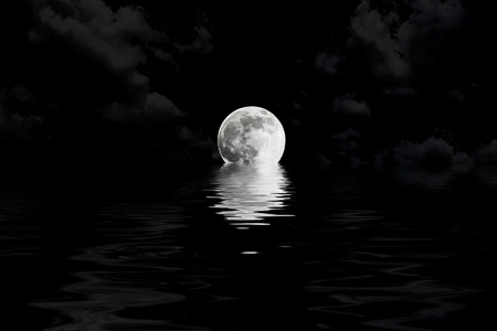 reflection in water: dark full moon in cloud with water reflection closeup showing the details of the lunar