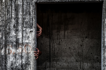 scary abandoned building with hand coming out of a door Stock Photo