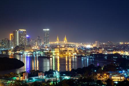 Bangkok cityscape. Bangkok night view of Bhumibol Bridge on Chao Phraya river and business district.