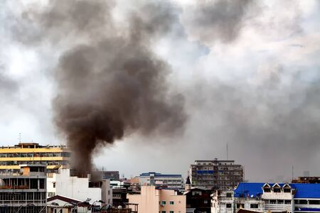heat loss: Fire burning and black smoke over the commercial building.
