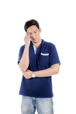Portrait of the thoughtful handsome asian man looks up with hand near face., isolated on white background.