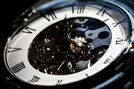 Close-Up of Luxury vintage mechanical watch with visible mechanism., In dark tone.
