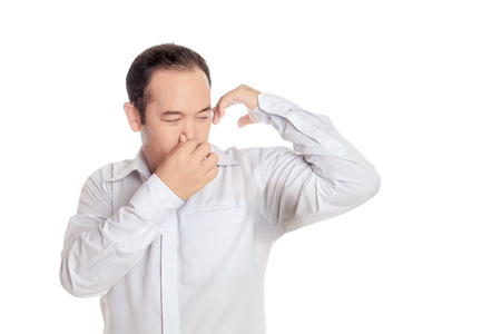 Asian man wearing shirt disgusting with bad smell of his wet armpit., Something stinks, negative human emotions, facial expressions, feeling reaction., Arm raised with transpiration stain underarm. Stockfoto