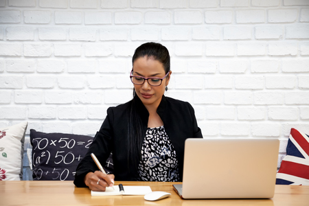 Beautiful asian business women are working with laptop in coffee shop.