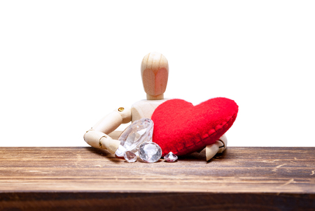 conscience: wooden dummies choose between diamond or heart, isolated on white background., love concept for valentines day. Stock Photo