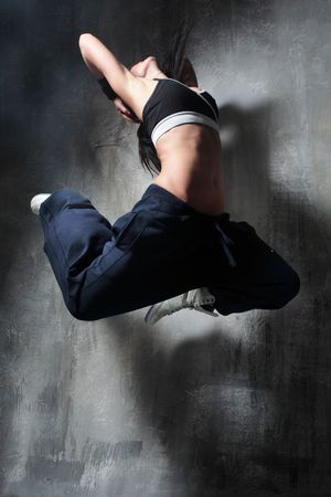 the dancer posing on dark grey background photo