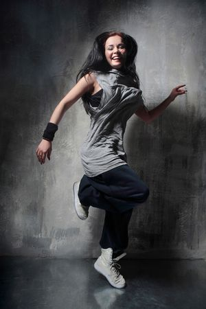 the dancer posing on dark grey background Stock Photo - 3030040