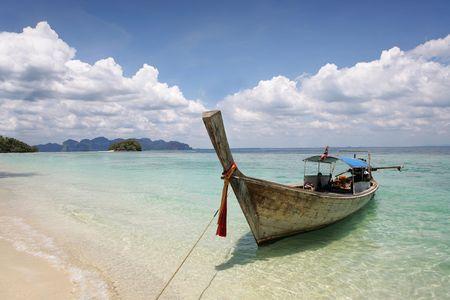longtail: beautiful longtail boat on the sand seashore