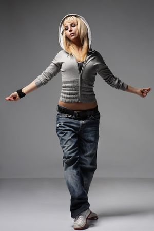 aerobica: young female dancing on a grey background Stock Photo
