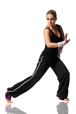 aerobica: giyoung female in black clothes doing fitness exersize and dancing Stock Photo
