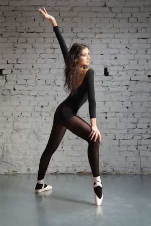 young, cute and beautiful ballet dancer posing photo