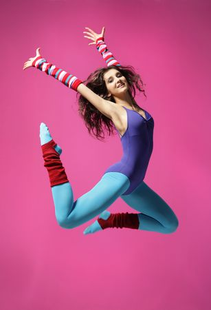aerobica: cool girl jumping on the magenta background Stock Photo