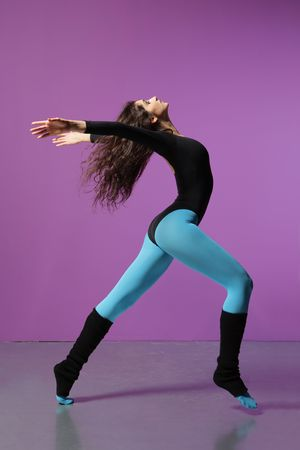 sport woman doing exercise on magenta background photo