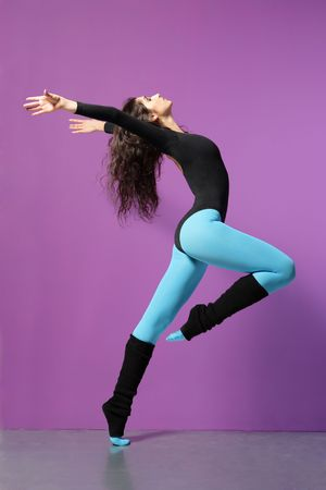 cool girl jumping on the magenta background photo