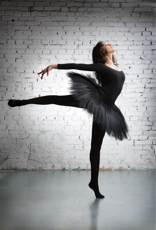cute, young and beautiful ballet dancer posing photo