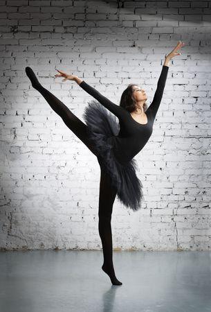 acrobatic: cute, young and beautiful ballet dancer posing