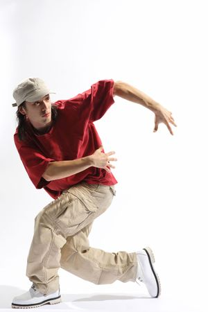 hip-hop style dancer posing on isolated background Stock Photo