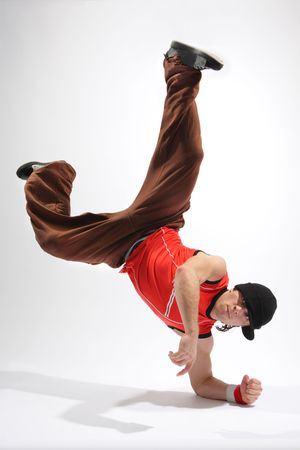hip-hop style dancer posing on isolated background photo