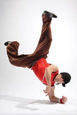 hip-hop style dancer posing on isolated background Reklamní fotografie