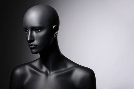 face of mannequin grey background photo