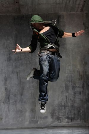 freestyle: coll looking dancer posing on a grunge grey wall