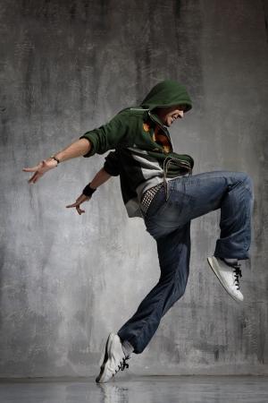 freestyle: Nightclub dancer posing on a dark background Stock Photo