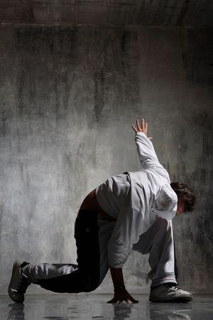 Nightclub dancer posing on a dark background Stock Photo