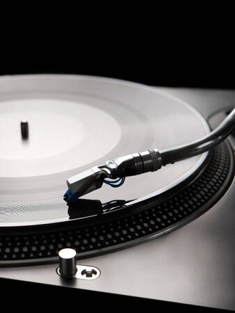 Macro shot of vinyl player with backlight photo