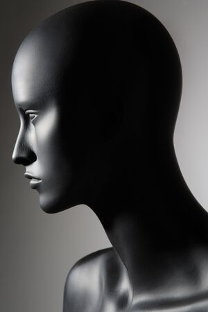 the mannequin standing alone on grey background photo