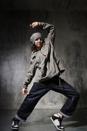 hip-hop style dancer posing on a grunge wall background Stock Photo - 3038777
