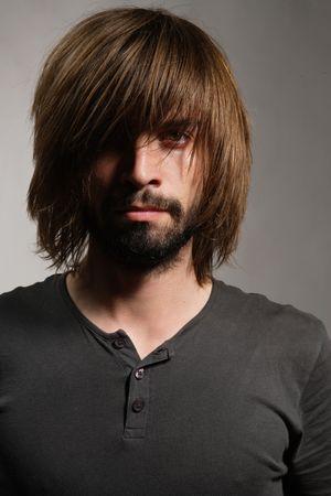 busy beard: Man with a beard and long hair