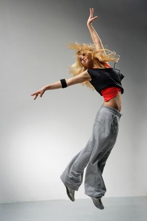 modern ballet dancer dancing on the grey studio background Stock Photo