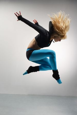 modern  dancer dancing on the grey studio background