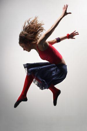 modern ballet dancer dancing on the grey studio background photo