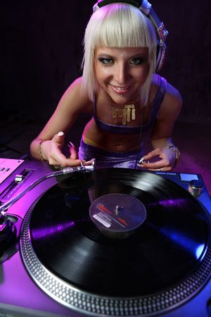 beautiful girl dj playing on vinyl player Stock Photo - 3202470