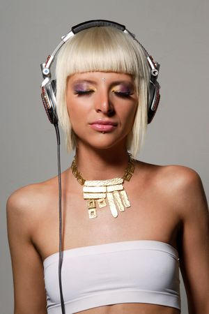young beautiful girl dj listening the music photo