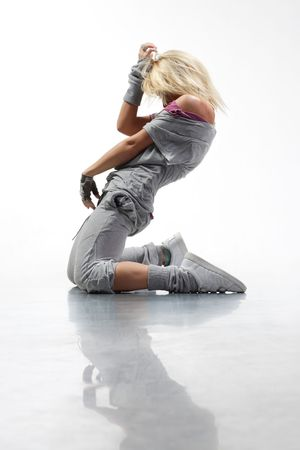 beautiful young hip-hop dancer posing on white background photo