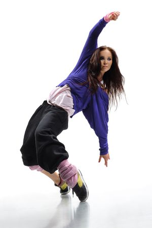 rap: beautiful young hip-hop dancer posing on white background