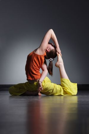 young beautiful woman doing yoga exercise photo