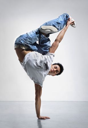 breakdance style dancer doing freeze position