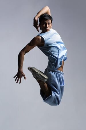 modern style dancer jumping on grey background Stock Photo - 3355188