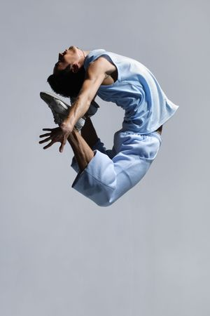 stylish modern  dancer jumping on grey photo