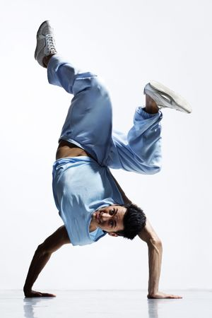 cool breakdance style dancer posing in freeze position Stock Photo - 3355183