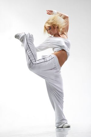 cool looking and stylish hip-hop dancer posing on white background Stock Photo - 3400030