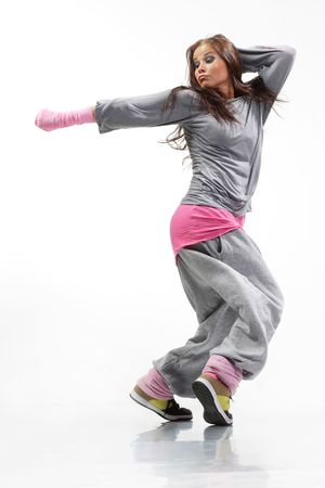 dance pose: cool looking and stylish hip-hop dancer posing on white background Stock Photo