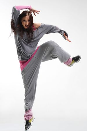cool looking and stylish hip-hop dancer posing on white background photo